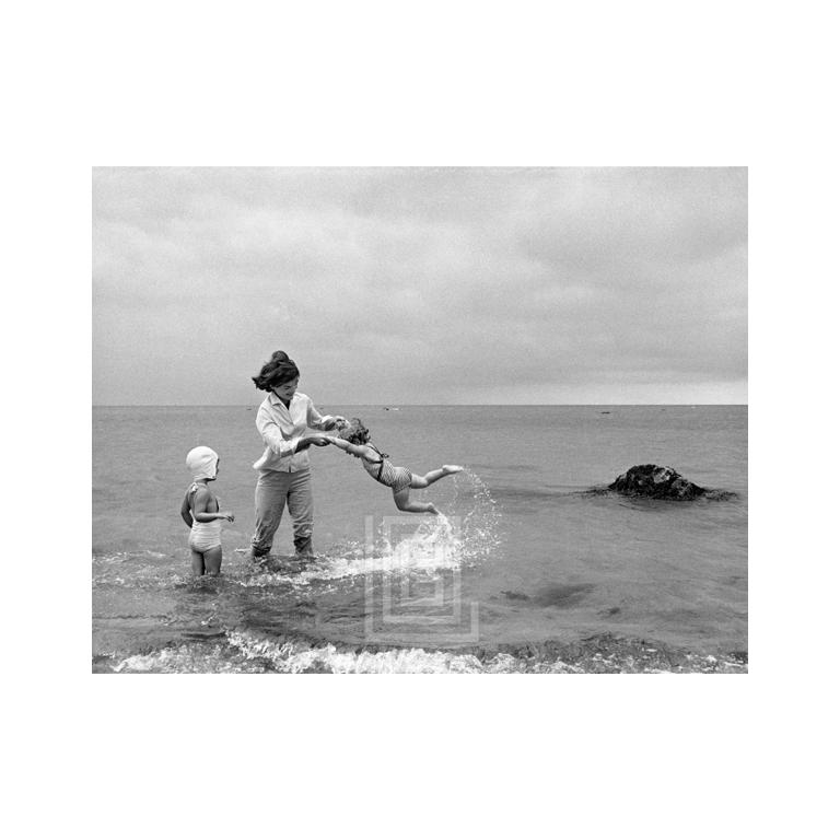 Mark Shaw Black and White Photograph - Kennedys, Hyannis Beach, Jackie Swinging Caroline with Cousin in Water, 1959