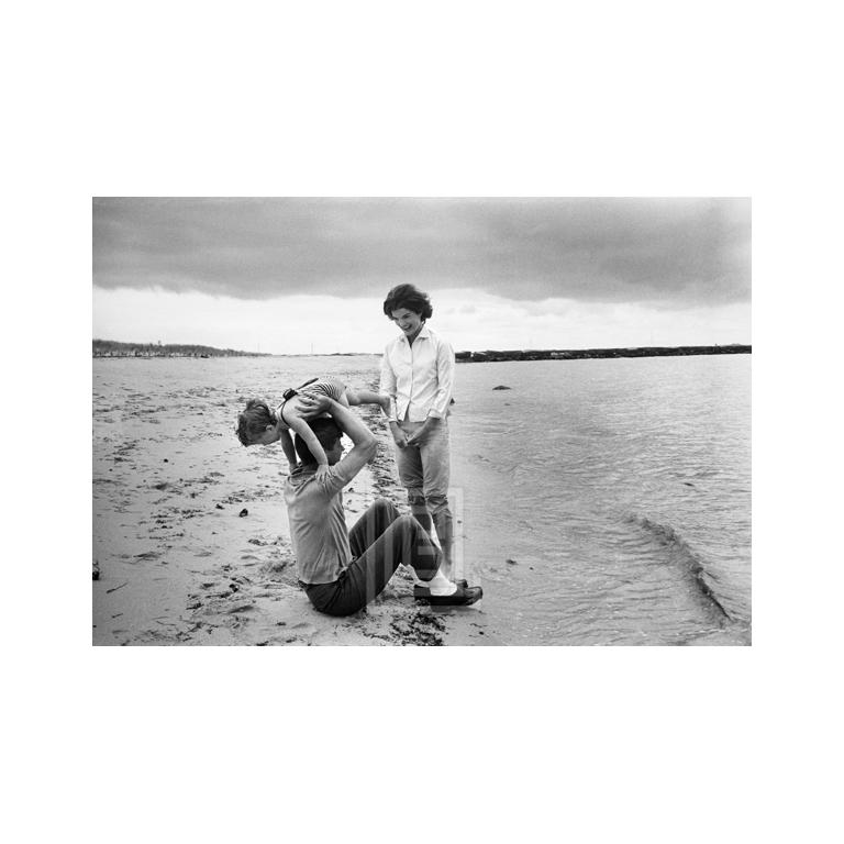 Mark Shaw Figurative Photograph - Kennedys, John Lifts Caroline Over His Head as Jackie Looks On