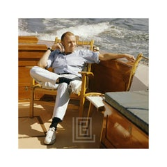Mark Shaw Seated on Boat, Looks Left