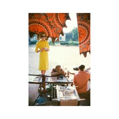 Tiger Morse in Yellow Suit Watches Sewing, 1962