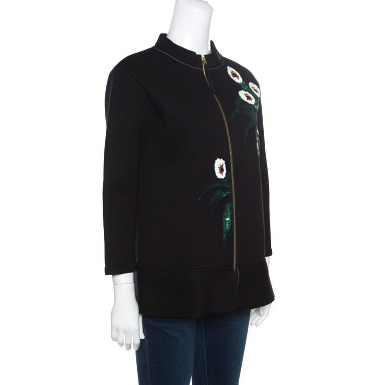 The stylish neckline, sequined floral embellishments and slightly peplum hem are the reasons why this jacket from Marni is an elegant option for evening outs. Featuring long sleeves, zipper fastenings on the front and comfortable paddings, the piece