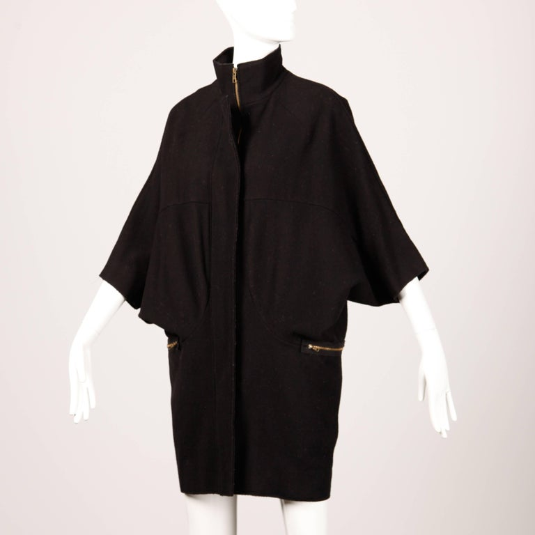 Chic black wool cape coat with dolman sleeves by Marni.  Details:   Unlined Front Zip Pockets Front Zip Closure Marked Size: 36 Estimated Size: Free Color: Black Fabric: Wool  Label: Marni  Measurements:  Hips: 40