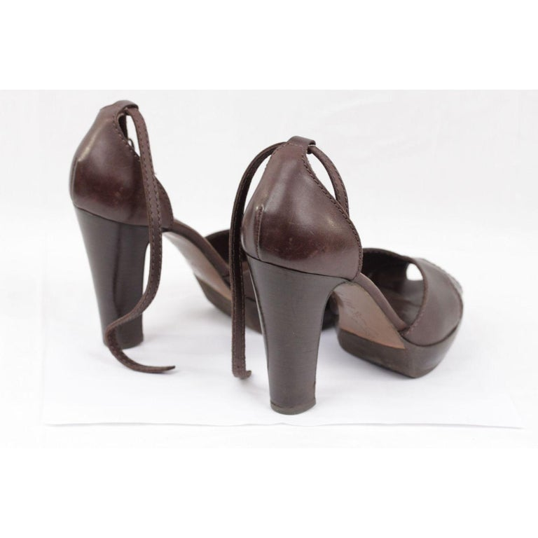 - High heels MARNI platform sandals crafted in brown leather - CrissCross detail at toe - Ankle strap buckle closure - Block heels - 4 inches - 10,2 cm heels - 1 inch platform - Leather upper, leather lining, leather sole - Made in Italy - Size : 39