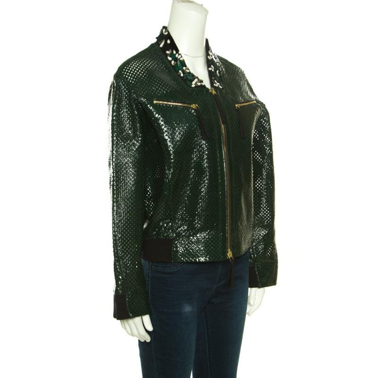 Marni brings you this fabulous bomber jacket to make you look chic, smart and very stylish! The green creation is made of a goat leather blend and features a perforated design pattern. It flaunts floral beads and sequins embellished collars, twin