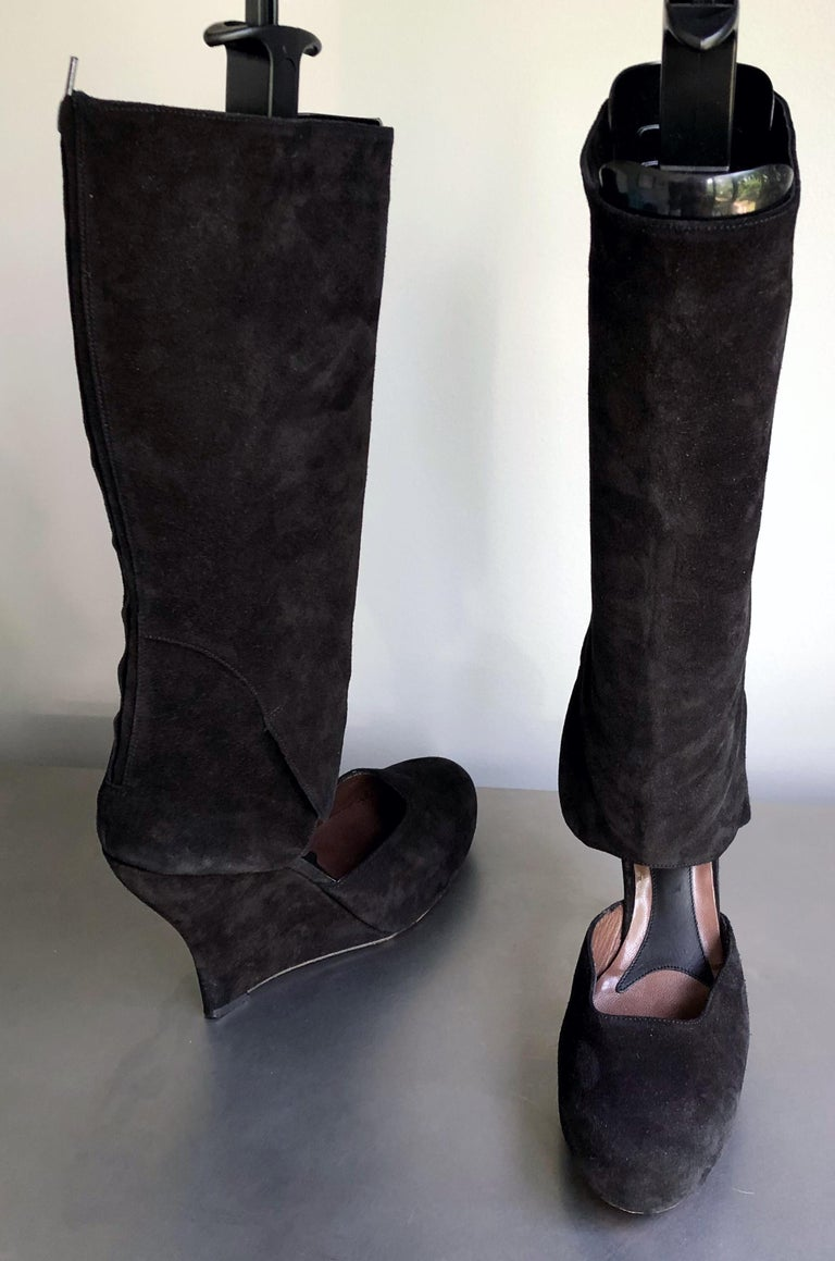 Early 2000s MARNI black suede leather cut-out knee high wedges boots ! The perfect statements boots that retailed for $1,700 when purchased. Can easily be dressed up or down, day or evening. Zipper up the inner calf.  Worn once for a photo shoot. In
