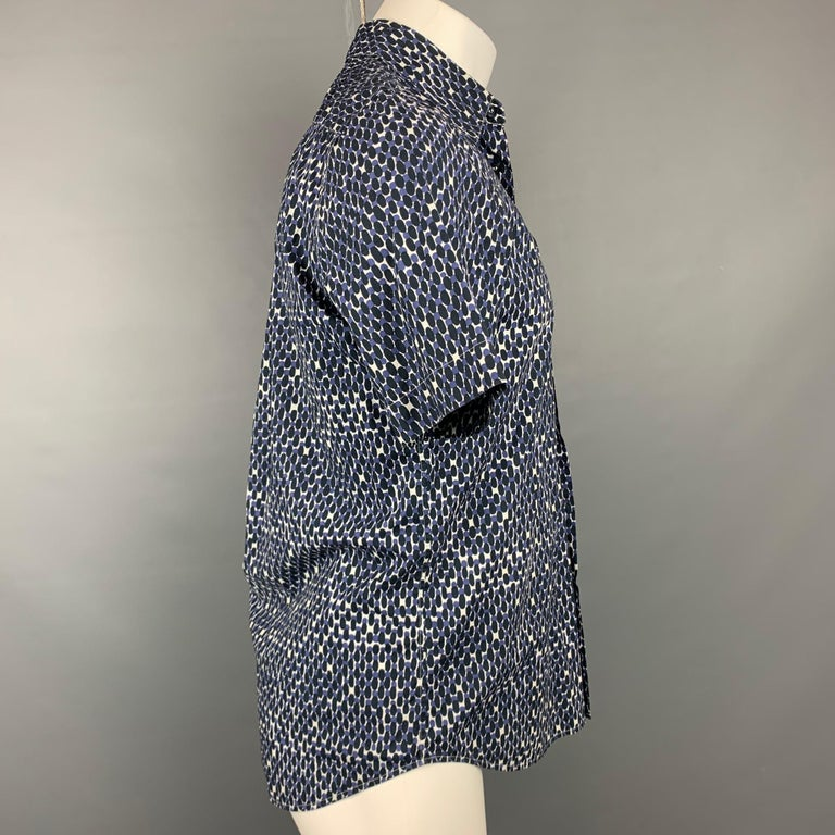 MARNI short sleeve shirt comes in navy & white print cotton featuring a button up style and a spread collar. Made in Italy.  Very Good Pre-Owned Condition. Marked: IT 46  Measurements:  Shoulder: 16 in. Chest: 40 in. Sleeve: 10 in. Length: 29 in.