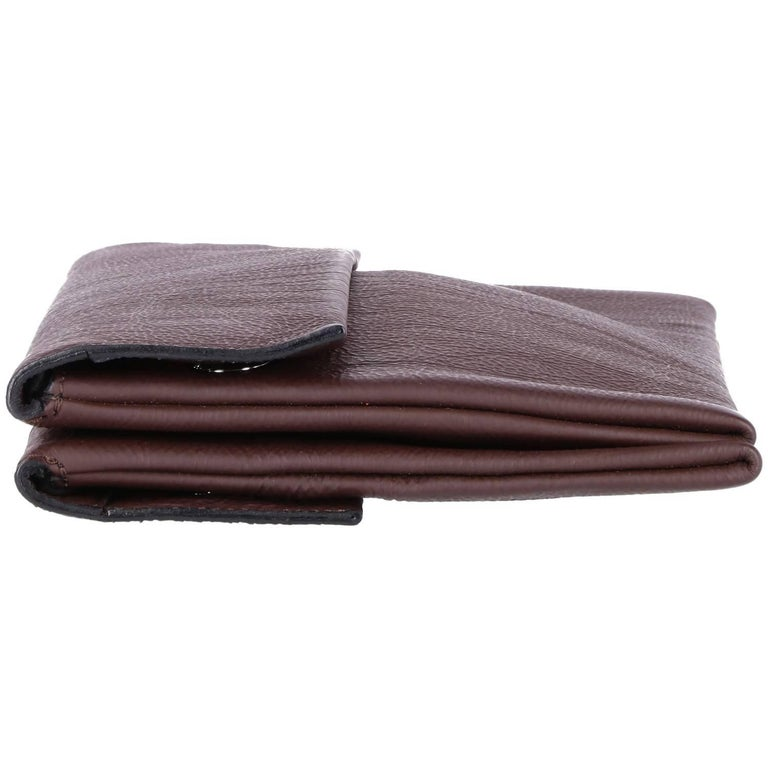 Soft brown leather clutch from Marni from the 2000s, featuring double pockets and a rectangular shape. Perfect conditions. Shows some points where glue came off (fixable) in the inside leather as shown in picture.  Height: 17 cm  Width: 32 cm