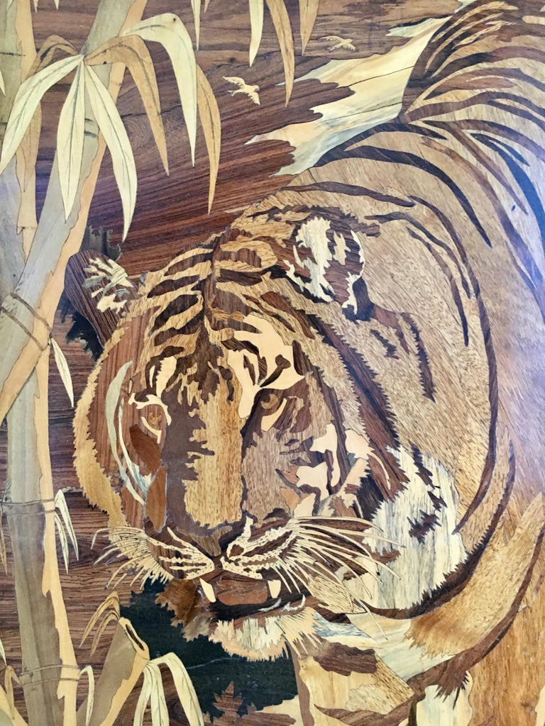 Intricately detailed inlaid marquetry image of a lion in the wild. Fabricated of cherry, maple, rosewoods and more. A handsome display of time and quality in this Folk Art piece - perfect for the nature, animal lover to proudly hang in many rooms.