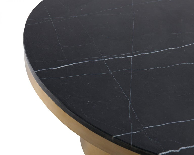 Marquina black marble and brass coffee table  Materials: Marquina black marble top, brushed brass frame and legs Dimensions: D 90 x H 38 cm.