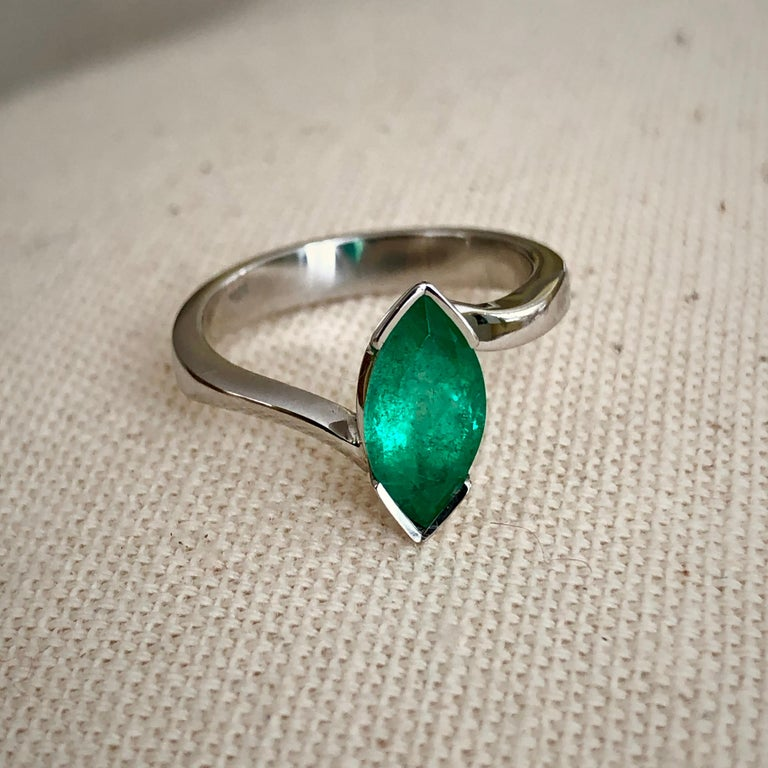 Vibrant green color 1.30 carat natural Colombian emerald marquise embedded in 18k white gold.  Ring size is 6.75( resizable) Ring Measurement: 12.0mm x 6.0mm, rising 5.2mm Total Ring Weight: 4.1g