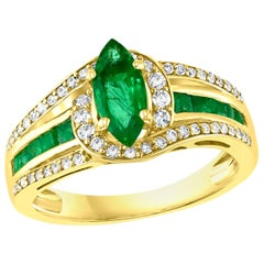 Marquise Cut Emerald and Diamond Ring 14 Karat Yellow Gold