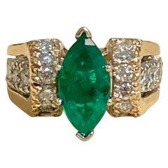 2.5 Carat Marquise Cut Emerald and Diamond Ring 14 Karat Yellow Gold
