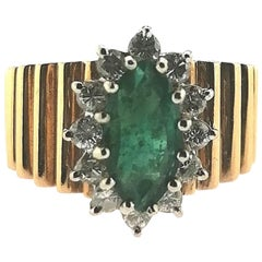 Marquise Cut Emerald and Diamonds Striated 18 Karat Yellow Gold Ring