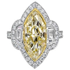 Marquise Cut Yellow Diamond Three-Stone Halo Engagement Ring
