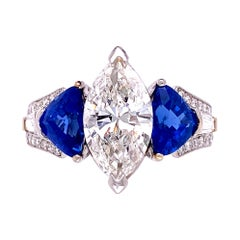 Marquise Diamond and Sapphire Three Stone Platinum Ring Estate Fine Jewelry
