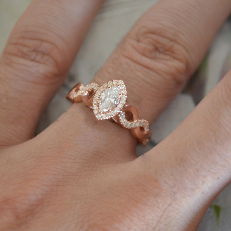 Modern Marquise Diamond Halo Engagement Ring Set in Rose Gold and Diamonds Twist Shank For Sale