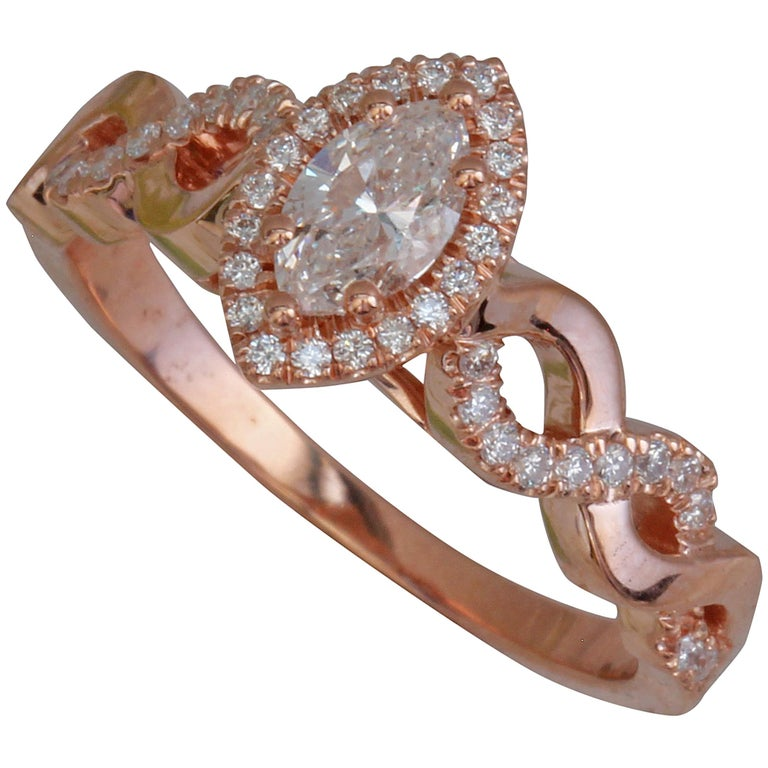 Marquise Diamond Halo Engagement Ring Set in Rose Gold and Diamonds Twist Shank For Sale