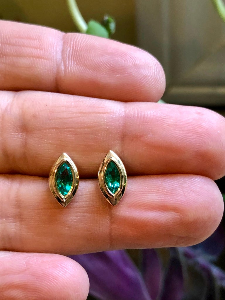 Emerald Stud Earrings Marquise Cut Colombian Emerald 18 Karat Yellow Gold Natural Medium AAA Green Color Marquise Cut Colombian Emeralds Weight approx.0.80 carat. Made of Solid 18K Yellow Gold. Push Backs Bezel Set