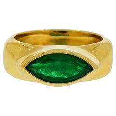 Marquise Shaped Emerald Yellow Gold Ring