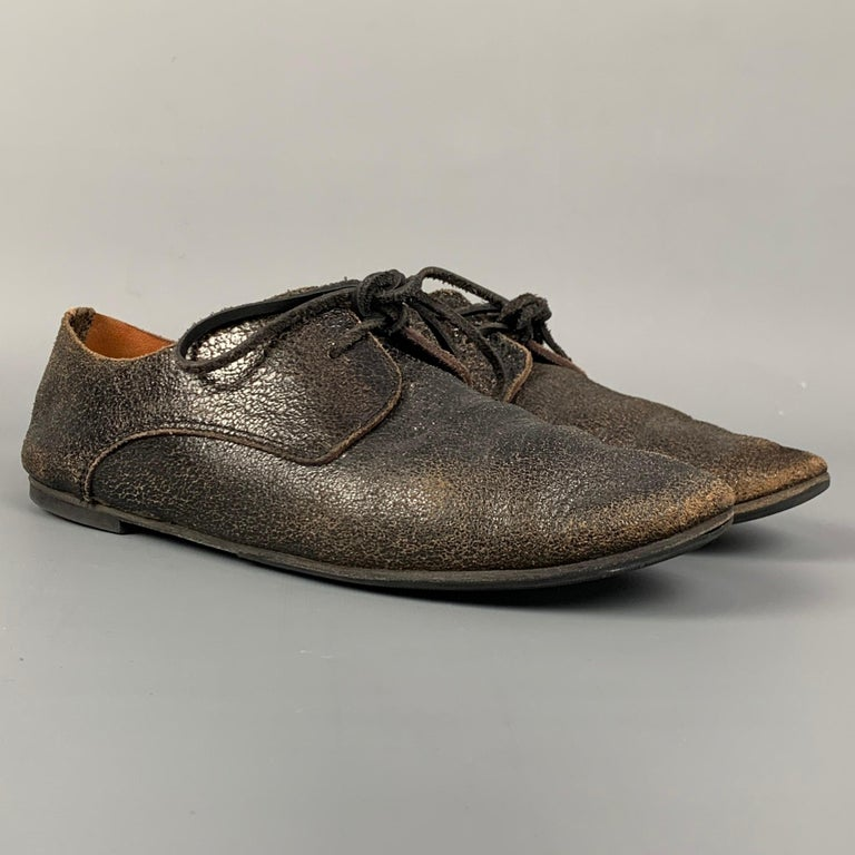 MARSELL flat laces comes in a dark brown cracked leather featuring a rubber sole and lace up closure. Made in Italy.  Good Pre-Owned Condition. Marked: 37.5 Original Retail Price: $800.00  Outsole: 3 in. x 10 in.