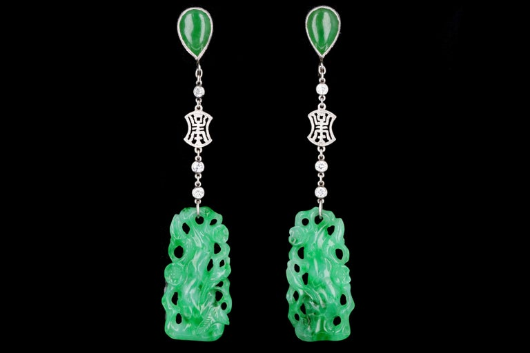 Designer: Marsh & Co.  Era: Art Deco  Composition: Platinum  Primary Stone: 2 Hand Carved Pieces Of Jadeite   Carat Weight: Approximately 22 Carats  Secondary Stone: 2 Cabochon Pear Cut Jadeite  Carat Weight: Approximately 2.5 Carats  Accent Stone: