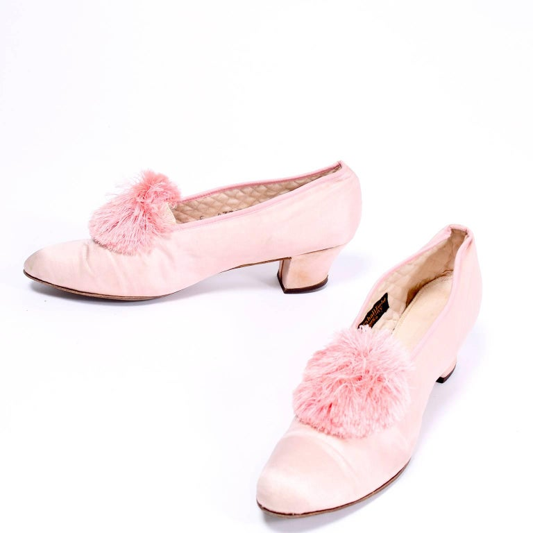 These beautiful pink satin shoes are from the late teens and we acquired them from an estate we purchased that included many high end articles of clothing and shoes from the 1910's through the 1960's.  This woman was a socialite who wore incredible