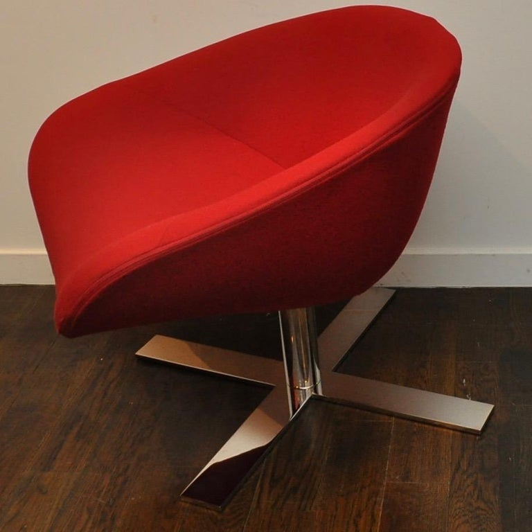 Gently used chair in red fabric atop a heavy, thick chrome swivel base in near perfect condition.