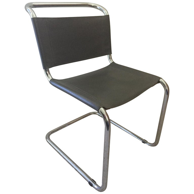 Pair of Mart Stam tubular chrome cantilevered chairs, with medium to light grey leather original seats and back, these chairs are similar to the design of Marcel Breuer chairs.
