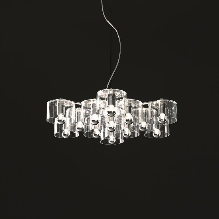 Suspension lamp 'Fiore' 433 designed by Marta Laudani & Marco Romanelli in 2007. Suspension lamp in transparent blown glass giving direct and diffused light. Chromium-plated metal structure with 13 lights. Manufactured by Oluce, Italy.  In