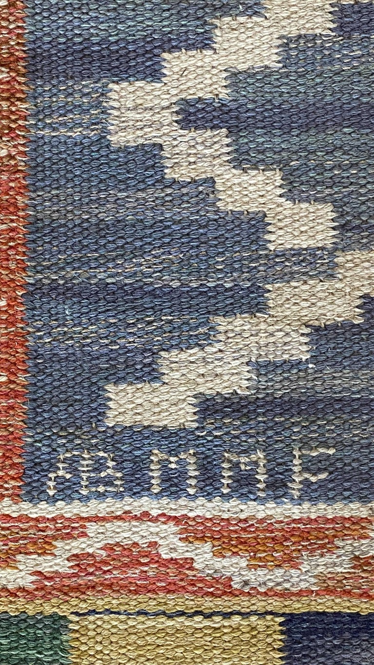 A rare handwoven modernist flat-weave carpet or rug by Märta Måås-Fjetterström. Handwoven in wool, using a Kilim technique. Signed. Designed circa 1950s.  Other artists include Berit Woelfer, Barbro Nilsson, Ann-Marie Hoke, Ingegerd Silow and