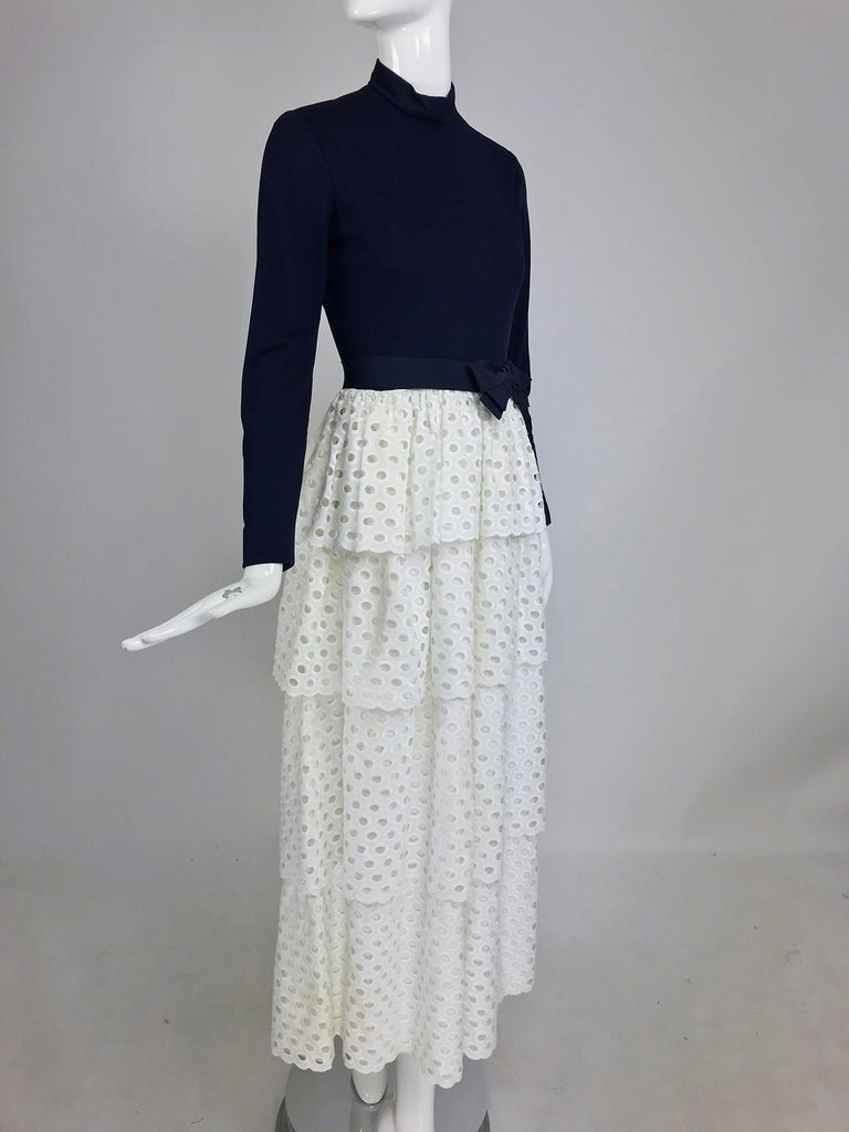 Martha Palm beach ink blue jersey tiered white eyelet maxi dress 1970s. This amazing dress is unique in that it's dark ink blue, which is a colour that doesn't turn up much anymore and that the skirt is bright white, the blue and white combination