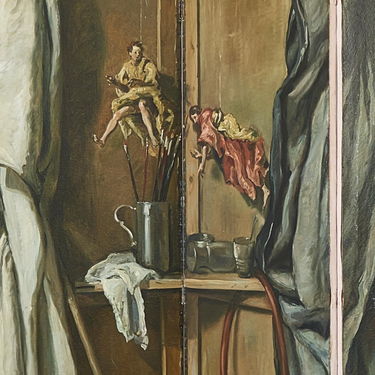 Painted folded screen from the mid-20 century by Martin Algaza, Argentina, painted in the surrealist style; with Trompe L'Oeuil painted curtains and realistic marionettes shown hanging from string. The scene filled with various objects from wine