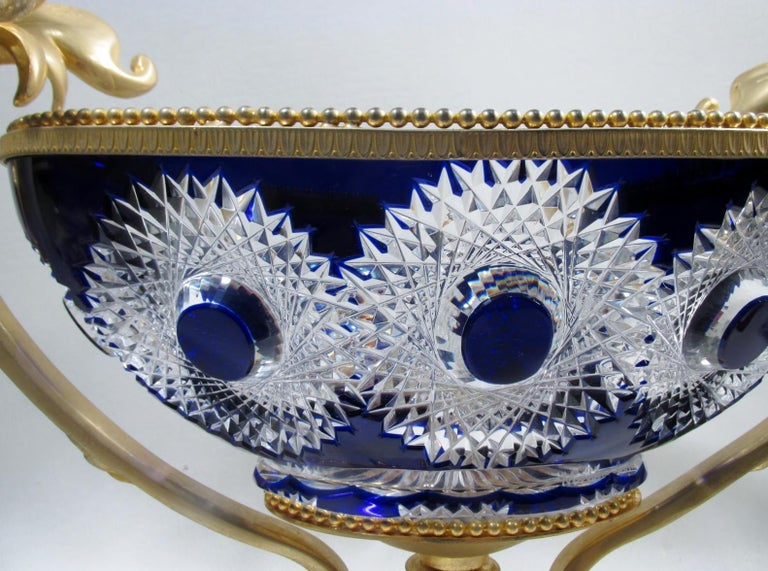 """Luxury at its finest, a rarely seen Martin Benito fine and heavy cobalt blue cut to clear centerpiece bowl in a gilt bronze doré mount of swans and Baroque scrolls. Made in France, this piece measures 13.75"""" to top of swan handles, 19.25"""" at widest,"""