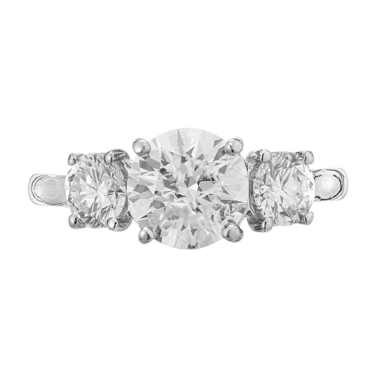 Martin Flyer handmade Diamond engagement Platinum ring. GIA certified round ideal brilliant cut center stone with 2, round ideal brillaint cut side stones in a three-stone platinum setting.   One diamond approx. total weight 1.52cts, round Ideal