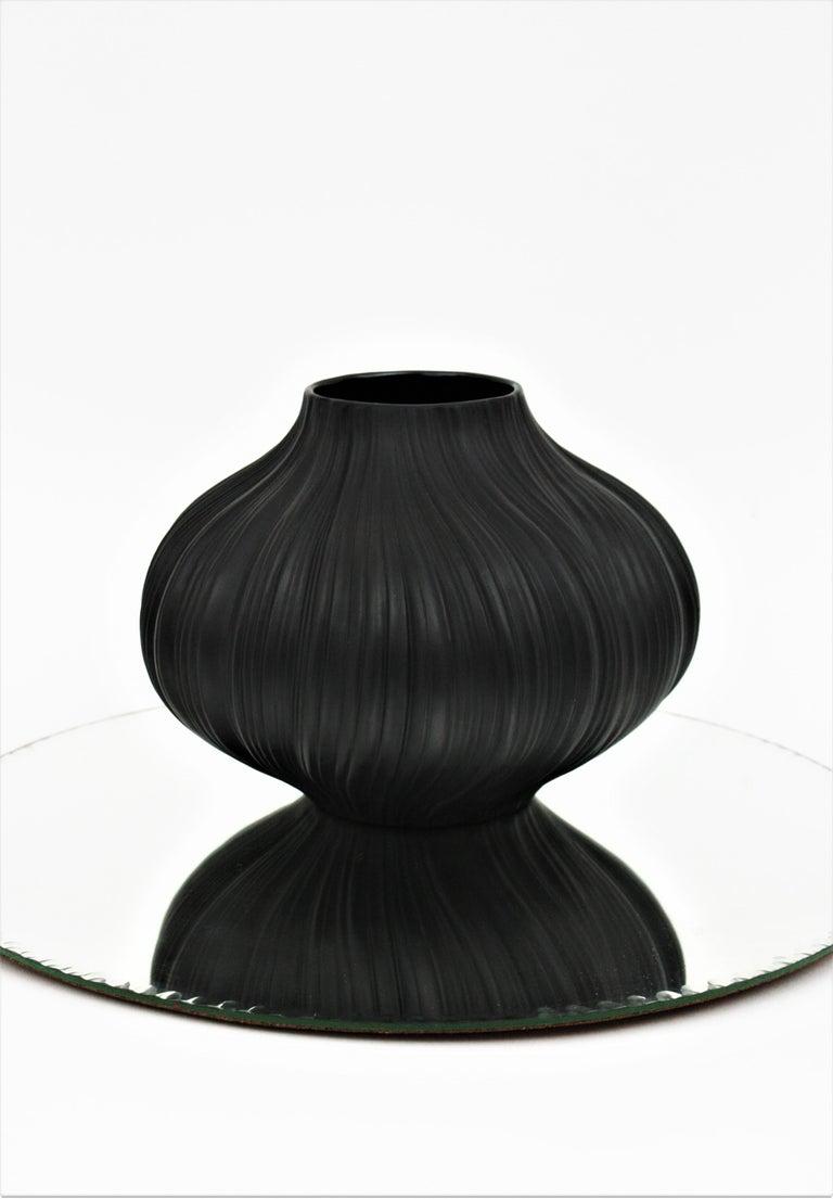 Elegant unglazed matte black large porcelain Plissée vase designed by Martin Freyer for Rosenthal Studio Line, Germany, 1960s Black unglazed porcelain. Signed underneath: Rosenthal porcelaine noire, Martin Freyer, Studio Line Born in 1909, Hans