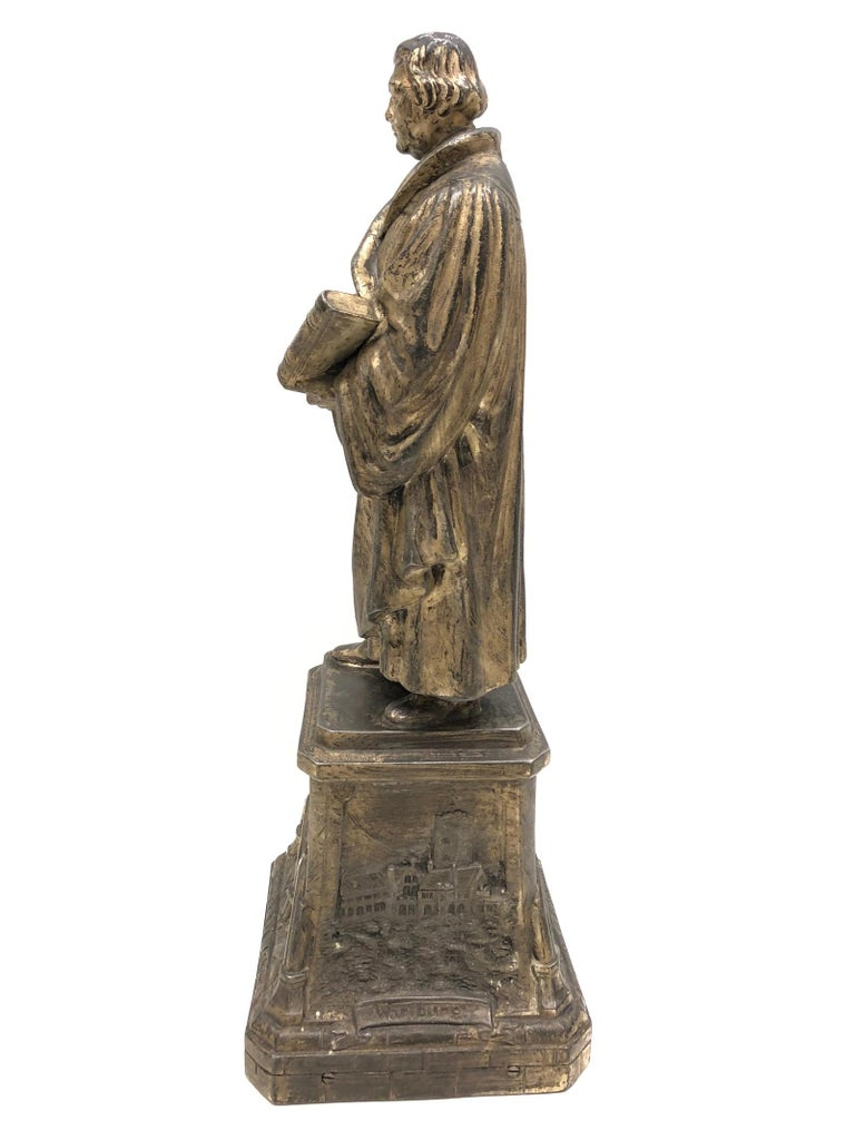 A decorative Martin Luther sculpture or statue. Some wear with a nice patina. Made of metal.