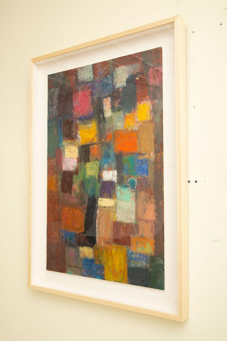 This wonderful and colorful vertical abstract signed and dated oil on paper by Martin Rosenthal 1968 has newly been custom framed in a light wood frame to compliment the multitude of glorious colors. It has a float of a white linen mat surround and