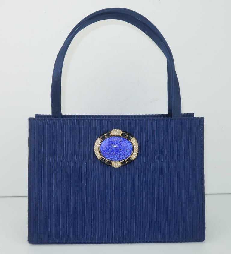 It's a Schaak attack!  A fabulous Martin Van Schaak dark royal blue fabric top handle handbag with a glass medallion decoration is on the prowl just waiting to add a dash of vintage glamour to your wardrobe.  Mr. Van Schaak's handbag designs are