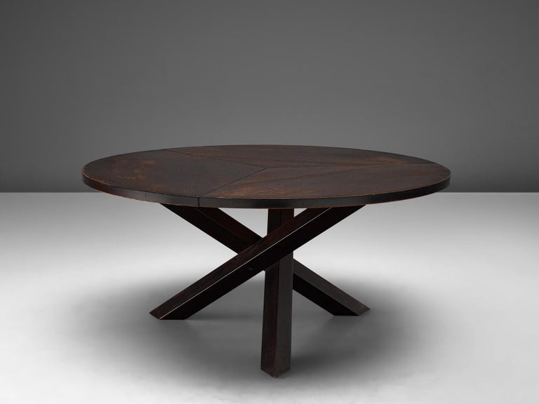 Martin Visser for 't Spectrum, dining table, in darkened wengé and wood, the Netherlands, 1960s.  Beautiful wengé dining table with round top, divided into three parts. The base consist of three crossed legs of solid, darkened wood. The veneer top