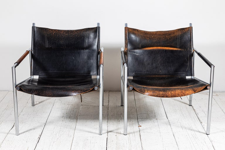 Martin Visser leather and chrome easy chair. The black leather is beautifully worn and aged. Three chairs are available.