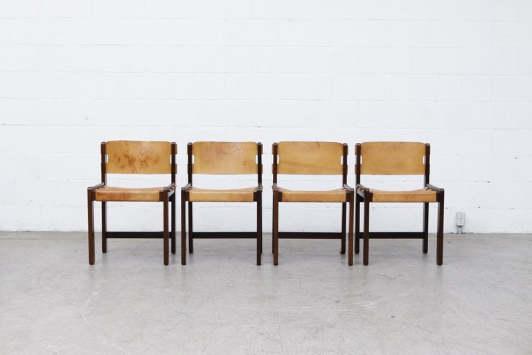 Gorgeous set of 4 Martin Visser leather dining chairs. Heavy Wenge frame with sling leather seating. Striking mid-century design, in original condition with visible wear and patina. Wear is consistent with age and use. Seat measures 17.375 x 14.5.