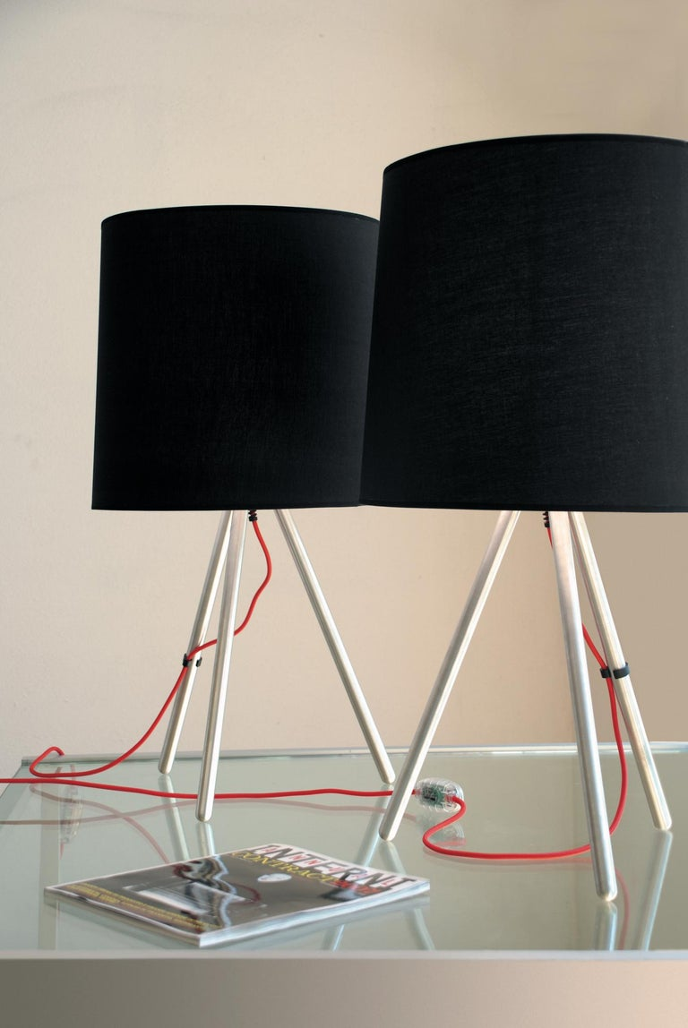 Designed by Emiliana Martinelli in 2007, Eva reproposes the traditional lamp with shade in a modern and technological version and also in the metal version. A simple form that inspires peace, though both for a Classic and modern