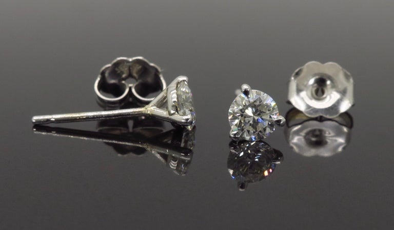 Martini style round brilliant cut diamond stud earrings crafted in 14k white gold.  Diamond Carat Weight: Approximately .53CTW  Diamond Cut: Round Brilliant Diamonds Color: Average G-H Clarity: Average VS2-SI1 Metal: 14K White Gold  Marked/Tested: