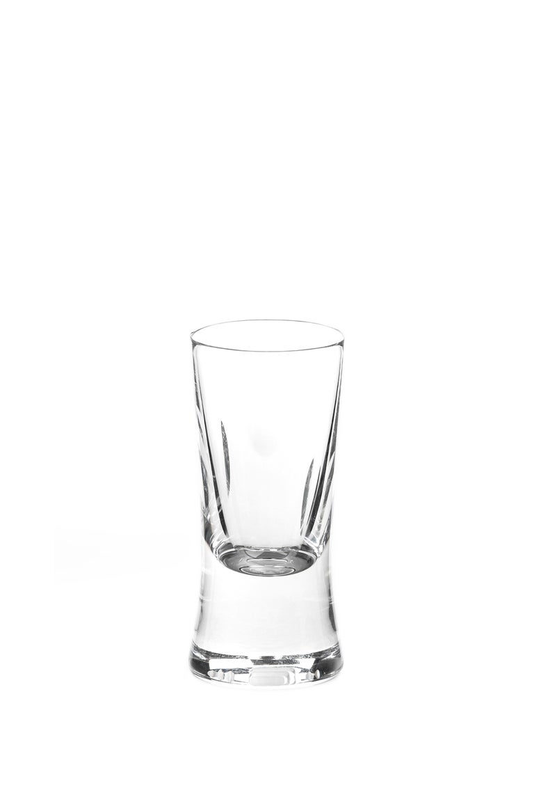 A shot glass made by hand Designed by Martino Gamper for J. HILL's standard as part of our 'CUTTINGS' collection.  Cuttings  The tactile crystal forms feel rugged and primitive in the hand; fingers naturally seek out the smooth hollows and
