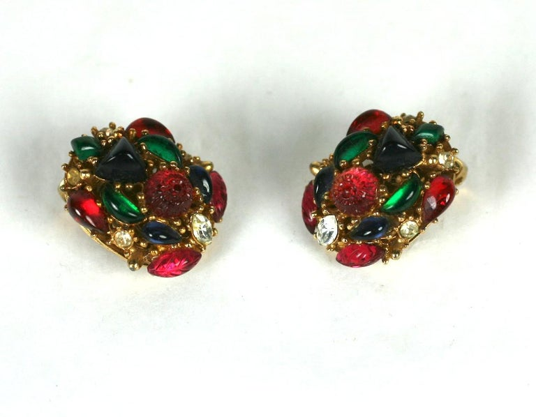 Marvella tri color fruit salad oval ear clips set in gold plate metal. Molded faux ruby, emerald and sapphire fruit salad stones are accented by crystal rhinestones. Excellent Condition, Clip back fittings Length .75