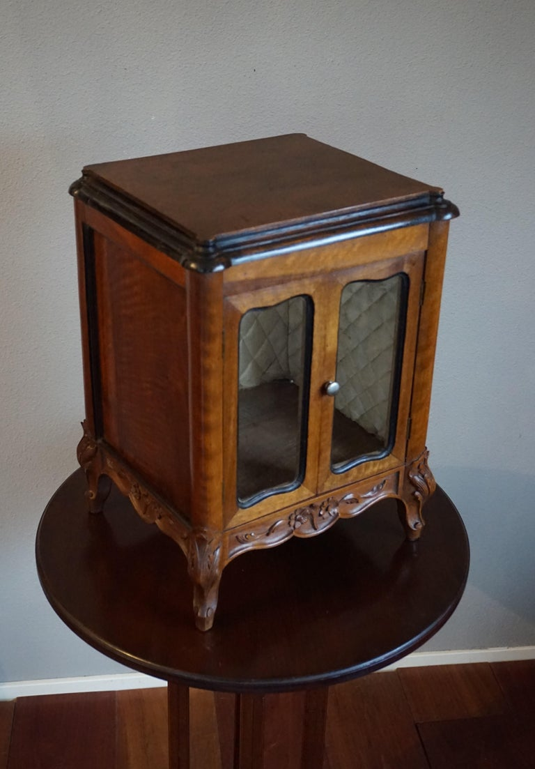 Antique French miniature cabinet with the best patina ever.  This beautifully designed and all handcrafted French masterpiece is an absolute joy to own and look at. The stunning and solid nutwood has aged beautifully and the warm color is unlike