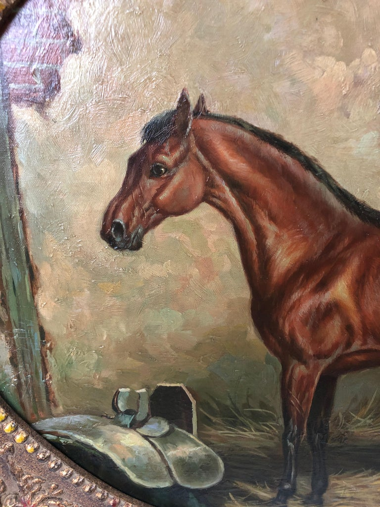 A rich equestrian portrait with mahogany thoroughbred in its stable, painted in realitic style and framed in a vintage rectangular bronze colored frame with oval opening.