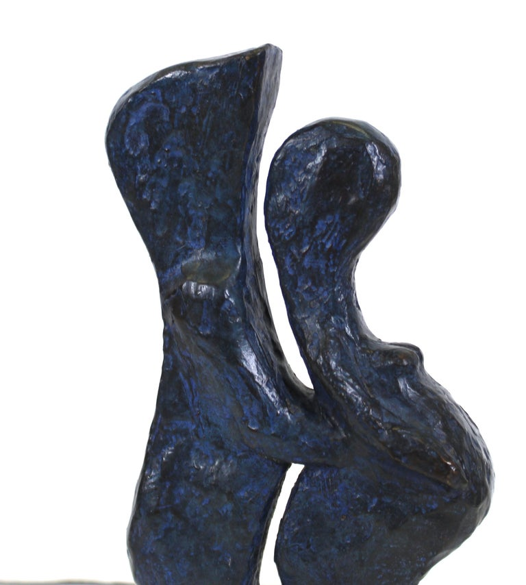 Modern abstract bronze sculpture of a couple in embrace, the woman appearing pregnant, sculpted by American artist Marvin Bell in 1984. The piece is signed and dated on the base and has the foundry name 'Roma Bronze Works' and edition number '1/21'.