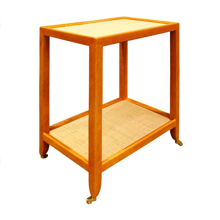 Telephone table covered in apricot python with natural Madagascar cloth tops on polished brass castors by Mary Forssberg, American 2019 (signed). This table is meticulously crafted and the combination of materials is very chic.