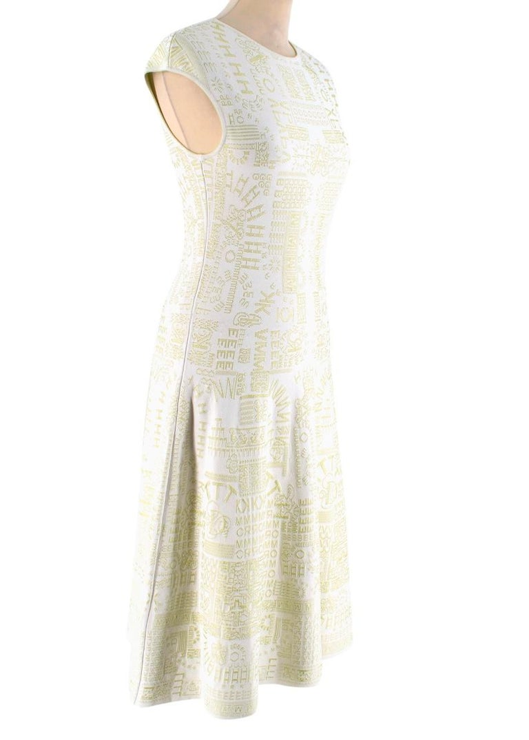 Mary Katrantzou Alphabet Babel Dress Pastel Green  - Rounded Neckline  - Cap Sleeve  - Stretch Fabric  - Midi Dress - Reverse Colour Lining  - A-Line Dress  88% Viscose  12% Elite  Dry Clean Only   Made in Italy   Sleeves: 15cm Chest: 36cm Waist: